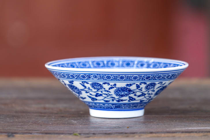 blue and white porcelian bowl on surface