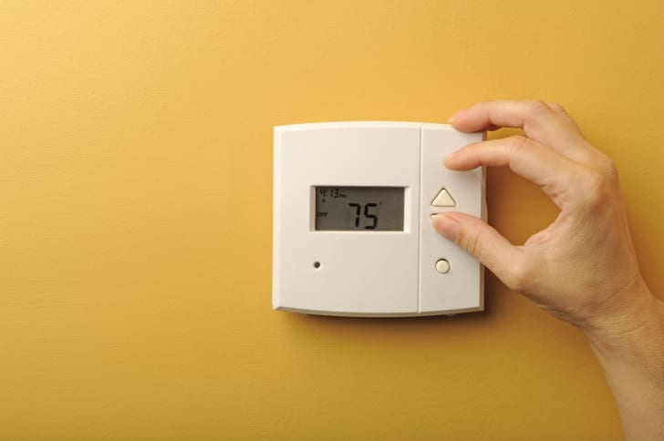 Thermostat on a yellow wall