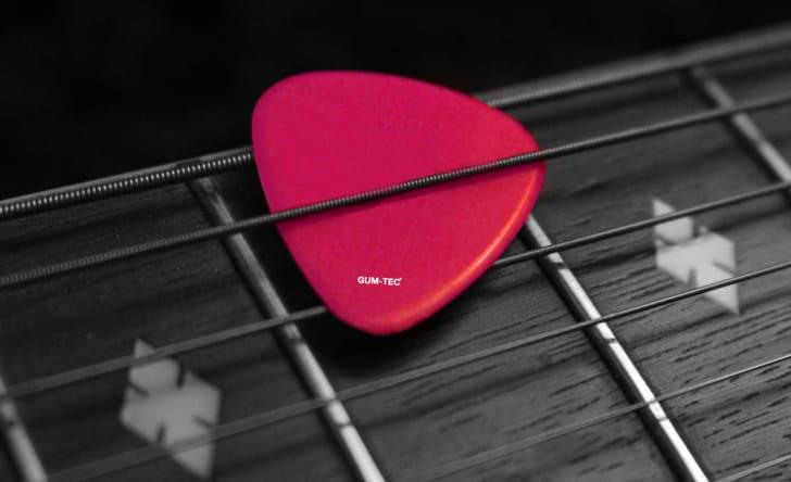 Pink guitar pick.