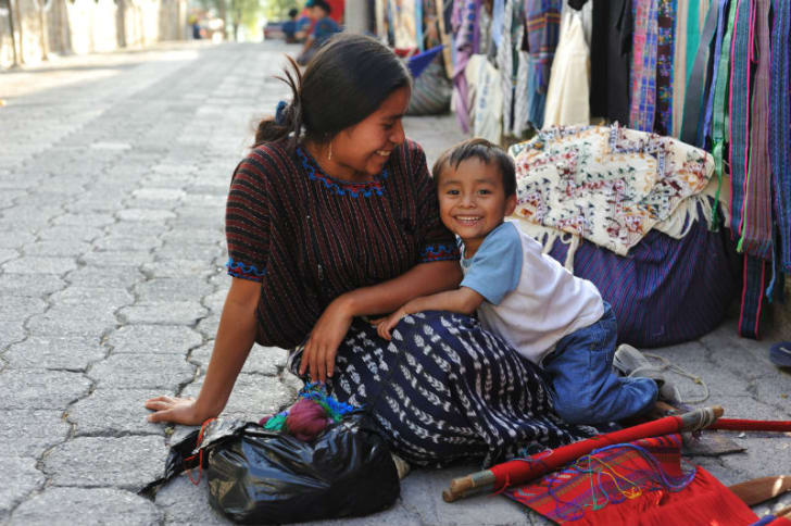 A woman sits with her child
