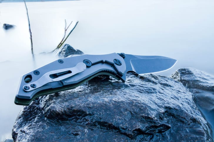 Tactical knife on a rock