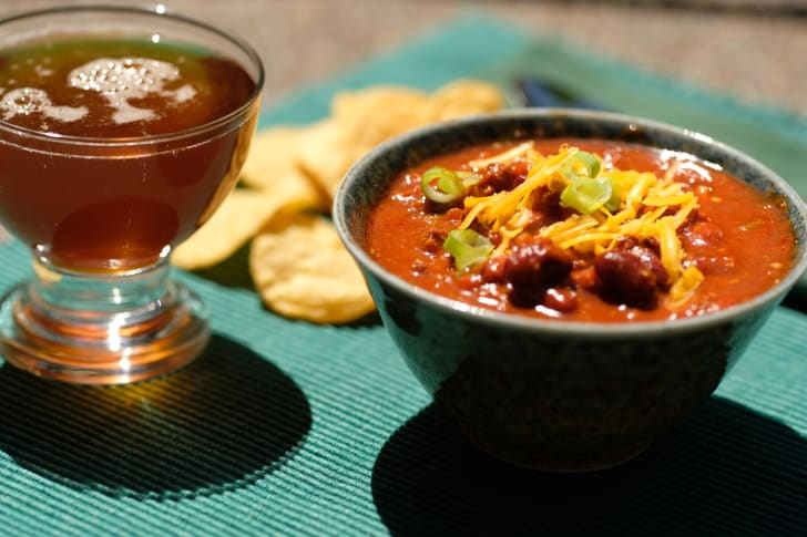 Bowl of chili with beer.