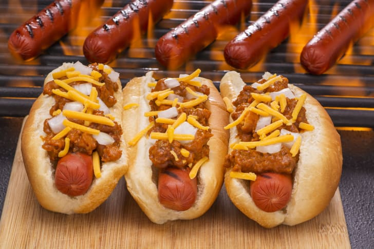Hot dogs with chili on a grill