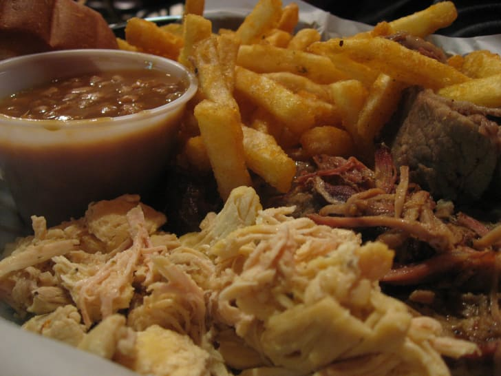 Plate of barbecue, chili, and fries.