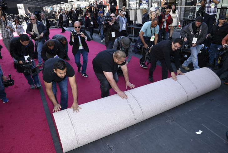 Workers unroll the red carpet at the 2017 Academy Awards