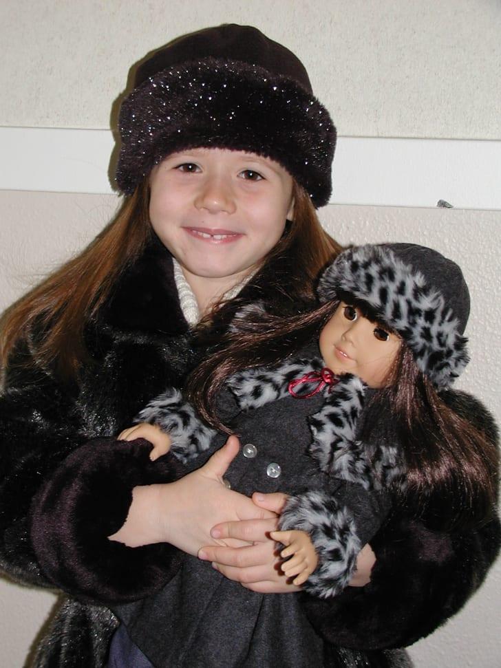 Girl holding American Girl doll