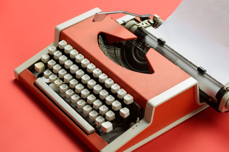 Picture of an orange typewriter