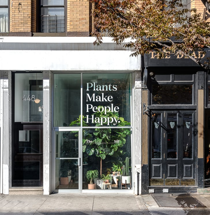 "The exterior of The Sill's Amsterdam Avenue location, which reads ""Plants Make People Happy."""