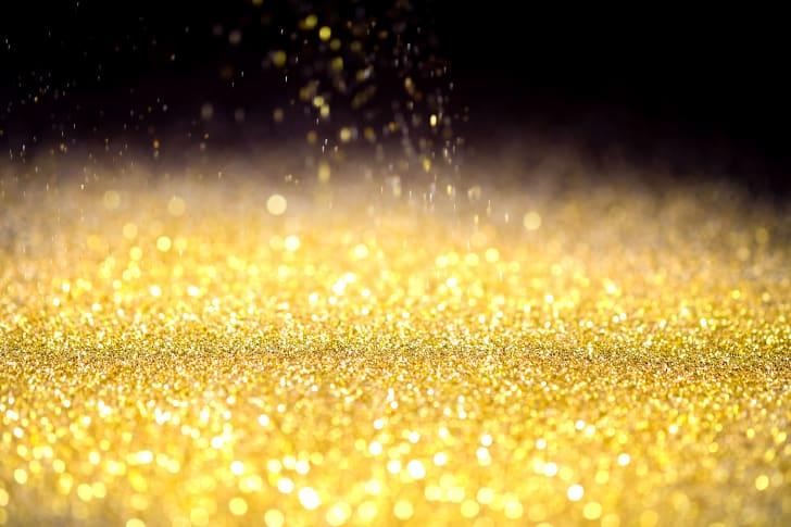Gold glitter on a black background