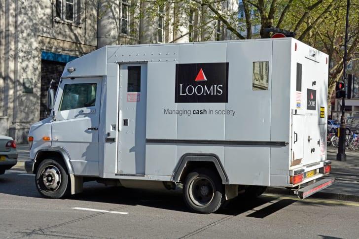 A Loomis van on a street.
