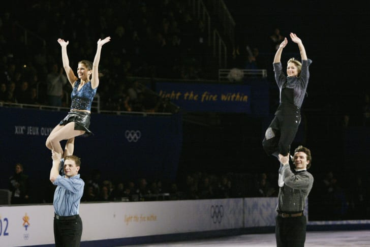 Pairs skaters Jamie Sale and David Pelletier of Canada and Elena Berezhnaya and Anton Sikharulidze of Russia perform in the figure skating exhibition during the Salt Lake City Winter Olympic Games at the Salt Lake Ice Center in Salt Lake City, Utah