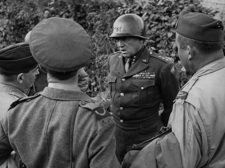 August 1944: General George S Patton (1885-1945), Head of the 3rd Army, talks to Allied war correspondents in Normandy.