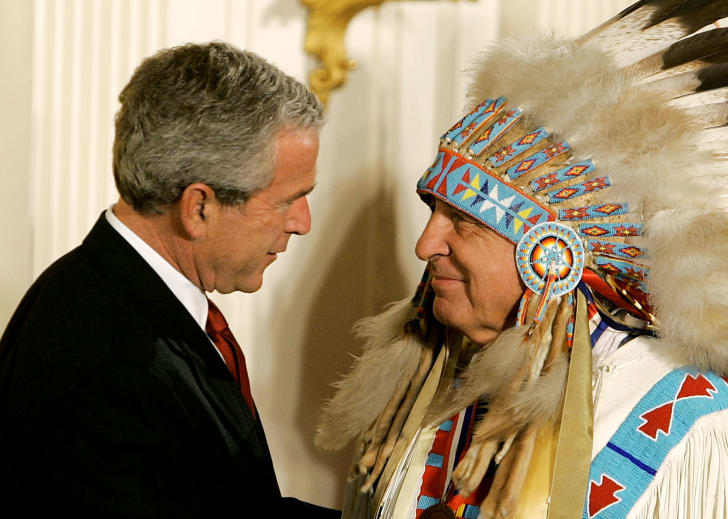 U.S. President George W. Bush shakes hands with Sen. Ben Nighthorse Campbell (R-CO) during a ceremony in the East Room at the White House.