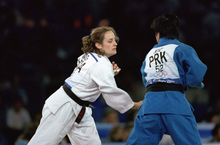 Hillary Wolf of the United States moves in for the attack against San Hui Kye of Korea in the Womens 52 kg Judo match at the Sydney Exhibition Centre during the Sydney Olympic Games in Sydney, Australia.