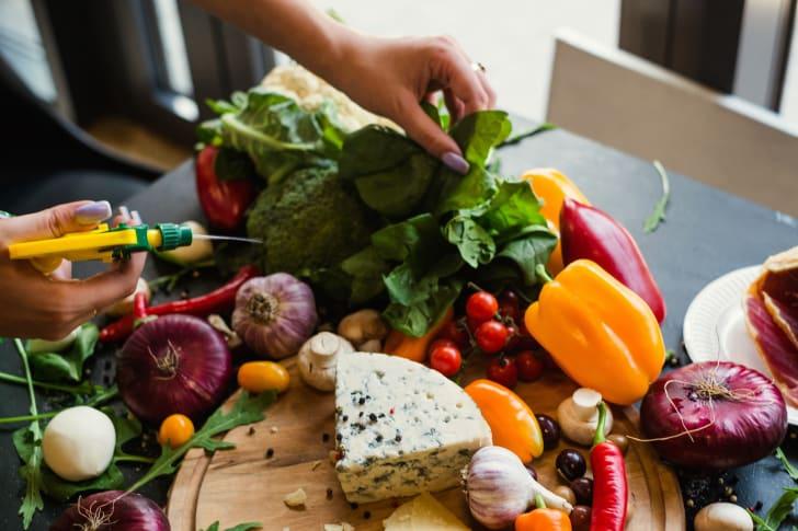 Food stylist preparing vegetables