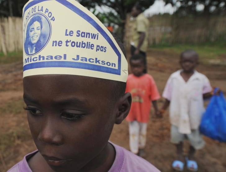 Young child in Krindjabo, Ivory Coast, wearing a hat memorializing Michael Jackson following his death.