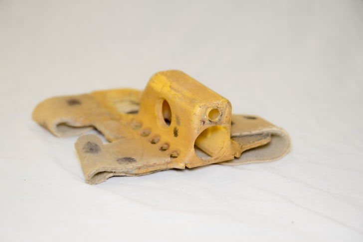 A holster used to attach a camera to a cheetah's head