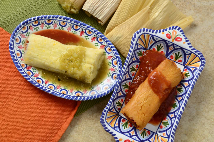 Tamales on a plate with salsa