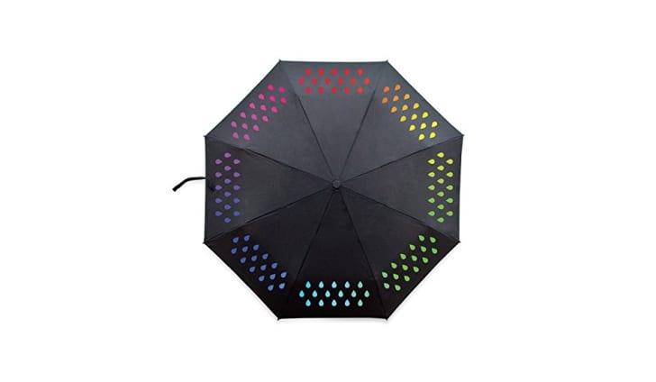Black umbrella printed with color-changing rain drop design