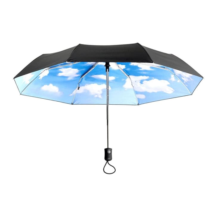 umbrella with interior of blue sky dotted with fluffy, white clouds