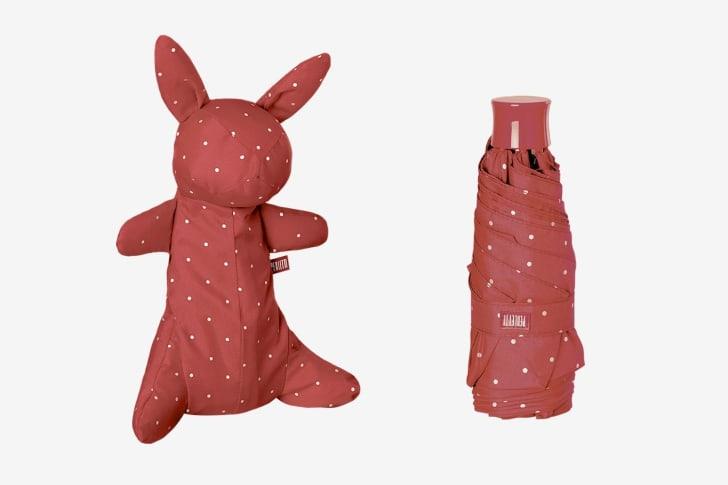polka-dot umbrella with a bag that's shaped like a bunny rabbit