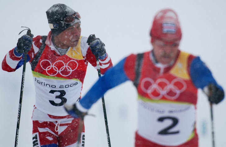 Prawat Nagvajara of Thailand (L) competes at the men's 15km classical of the 2006 Winter Olympics' cross country in Pragelato, 17 February 2006.
