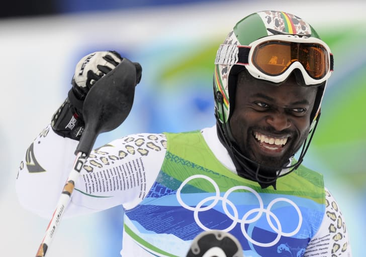 Ghana's Kwame Nkrumah-Acheampong celebrates finishing after the men's slalom race of the Vancouver 2010 Winter Olympics at the Whistler Creek side Alpine skiing venue on February 27, 2010.