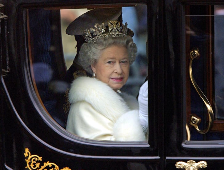 Queen Elizabeth rides in a carriage in 2000.