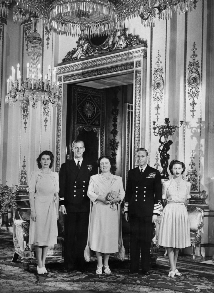 Princess Elizabeth, Philip Mountbatten, Queen Elizabeth (the future Queen Mother), King George VI, and Princess Margaret pose in Buckingham Palace on July 9, 1947, the day the engagement of Princess Elizabeth & Philip Mountbatten was officially announced.
