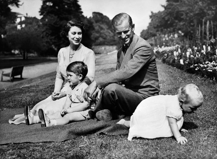 Queen Elizabeth and Prince Philip with two of their children, Prince Charles and Princess Anne, circa 1951.