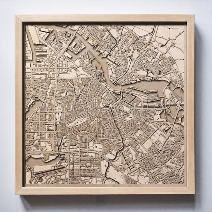Wooden map of city.