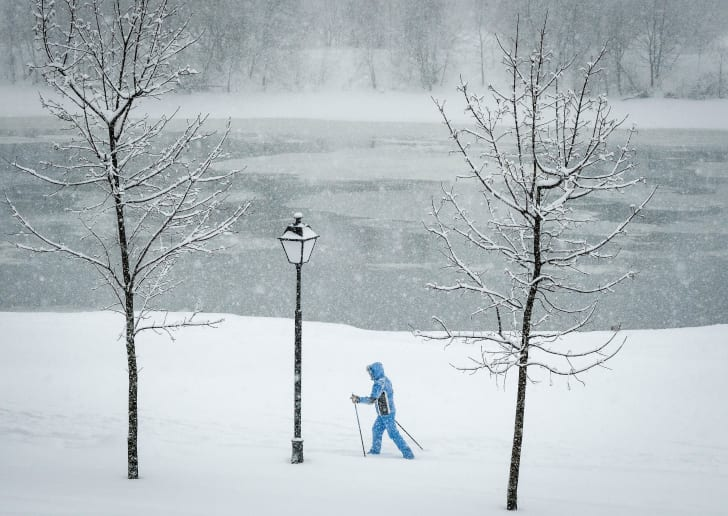Person cross-country skiing over snow in Moscow.