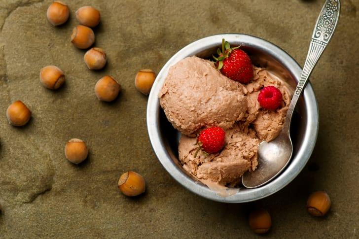 Bowl of ice cream with hazelnuts.