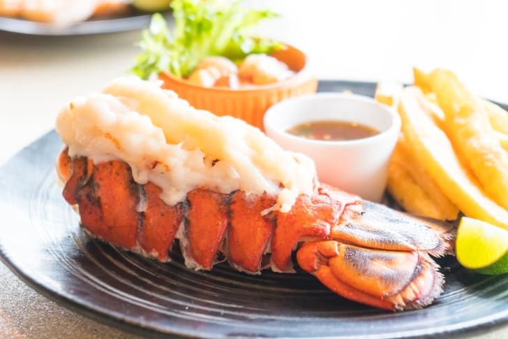 Lobster tail and dipping sauce on a plate