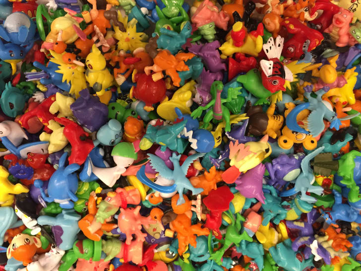 A large pile of colorful plastic toys