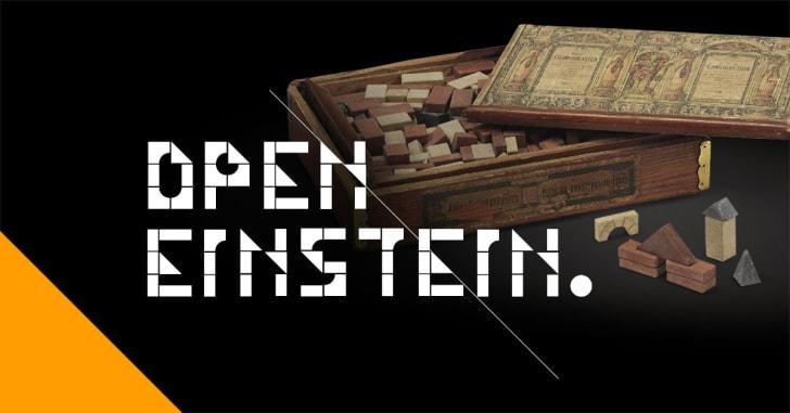 A dark image labeled 'Open Einstein' with wooden blocks in the background