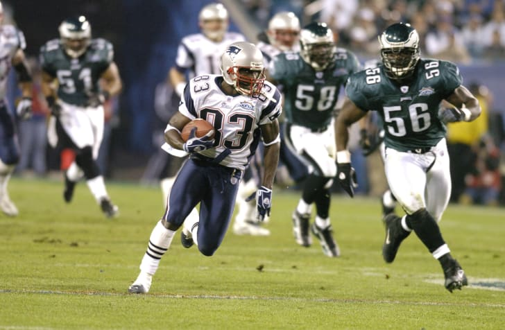 New England Patriots Deion Branch #83 runs with the ball during Super Bowl XXXIX between the Philadelphia Eagles and the New England Patriots at Alltel Stadium in Jacksonville, Florida on February 6, 2005