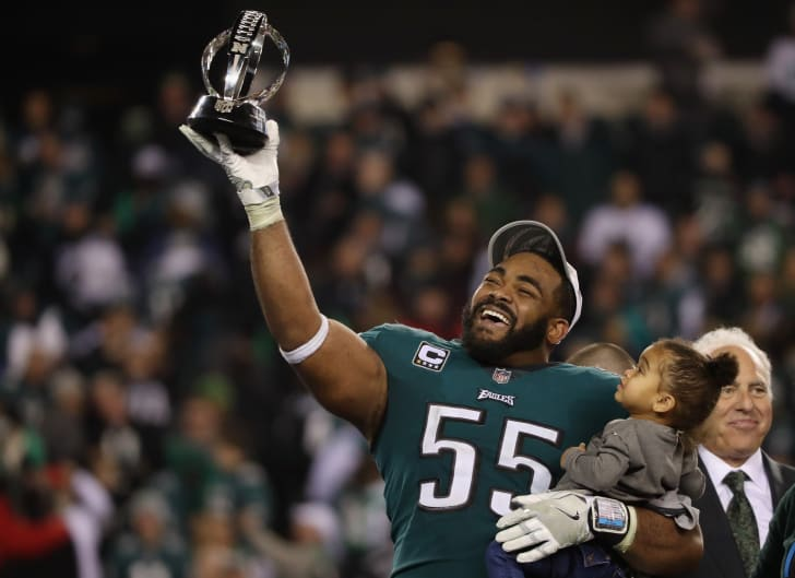 Brandon Graham #55 of the Philadelphia Eagles celebrates his teams win over the Minnesota Vikings with the George Halas Trophy after the NFC Championship game at Lincoln Financial Field on January 21, 2018