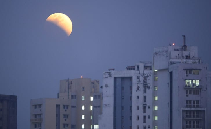 "The moon is seen during a lunar eclipse referred to as the ""super blue blood moon,"" in Kolkata on January 31, 2018."
