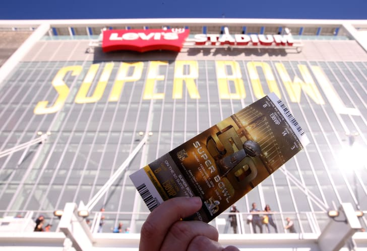 A fan held a ticket to the Super Bowl 50 in front of the Levi's Stadium on February 7, 2016 in Santa Clara, California.