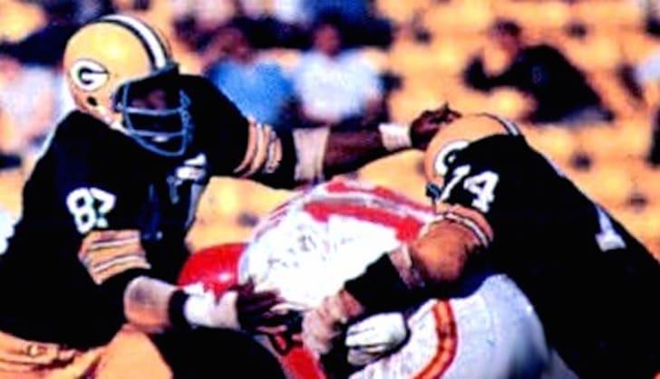 Green Bay Packers defenders Willie Davis (left) and Henry Jordan (right) compete against Kansas City Chiefs quarterback Len Dawson in Super Bowl I.