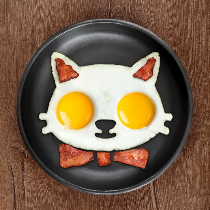 Eggs and bacon in a pan in the shape of a cat's face