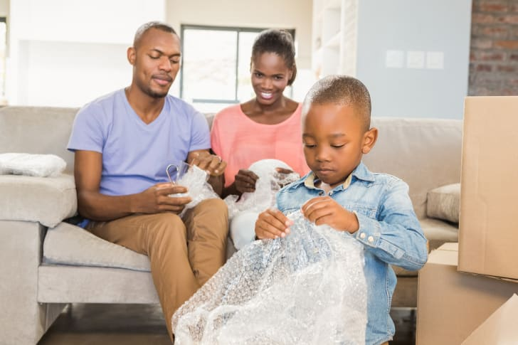 Child popping Bubble Wrap.