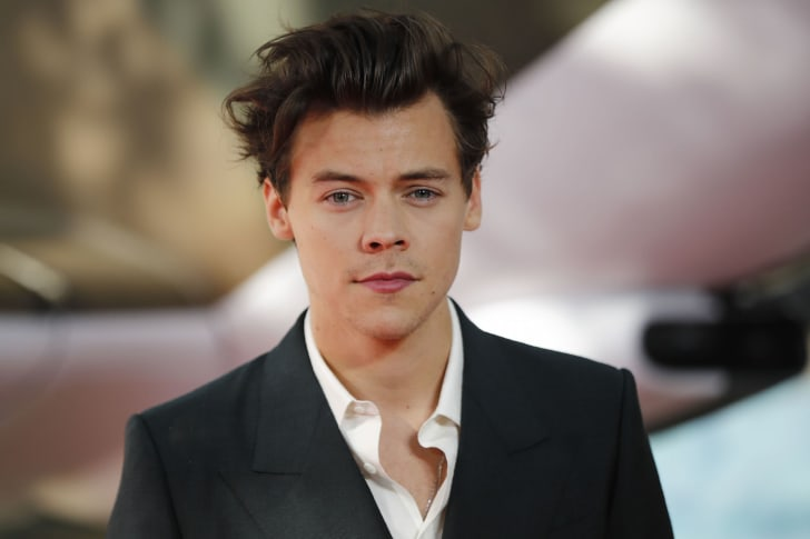 British singer Harry Styles poses for a photograph upon arrival for the world premiere of 'Dunkirk' in London on July 13, 2017