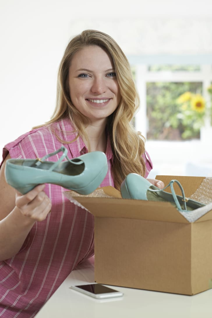 woman with box, shoes, and bubble wrap