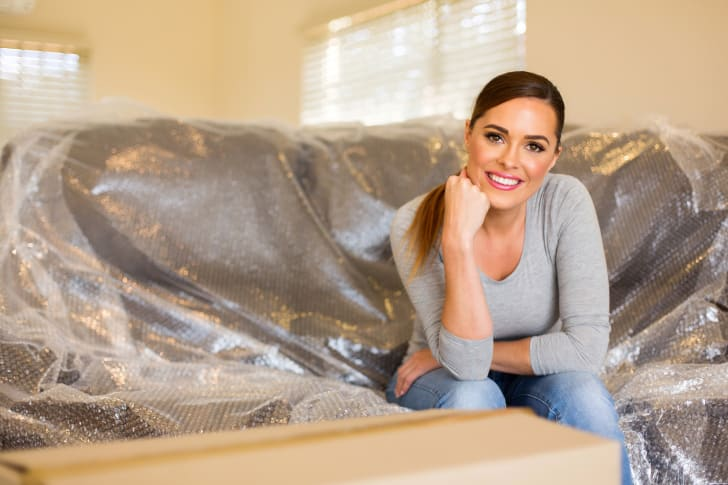 Woman relaxing on bubble-wrapped couch
