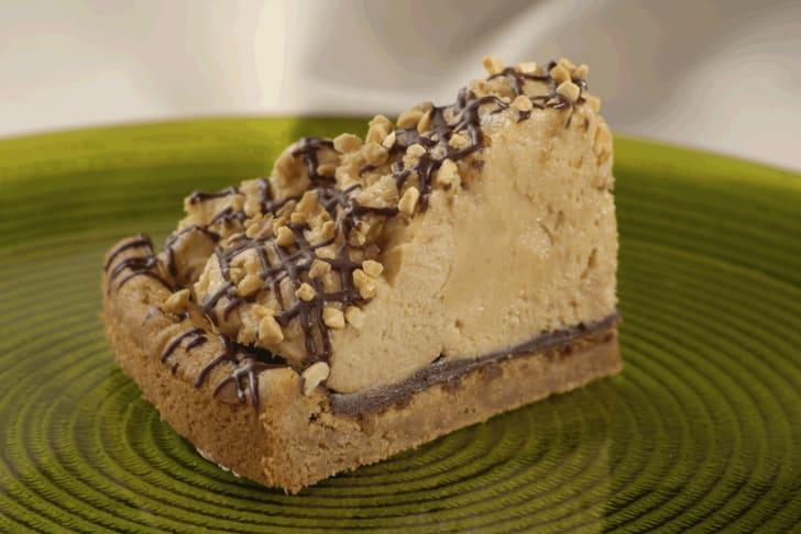 Slice of large chocolate pecan pie.