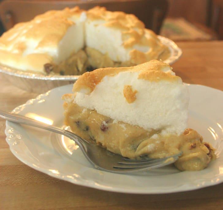A slice of sour cream raisin pie.