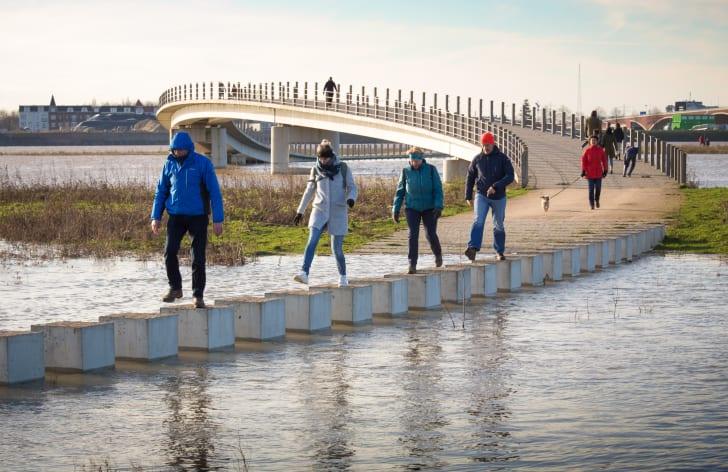People walking on bridge.