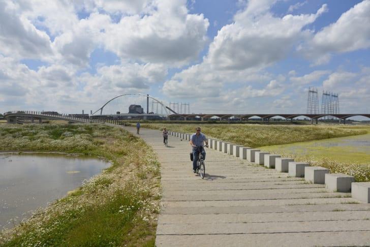 People biking on path.